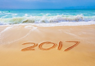 2017 written on the sand of a beach, travel 2017 new year concept