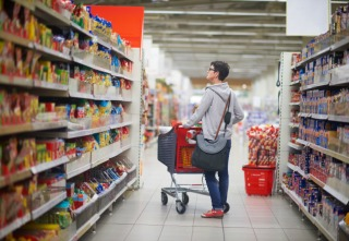 shopping woman in supermarket store buying food and grocery